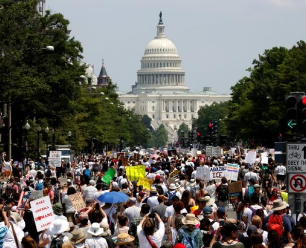 Immigration activists march to protest the Trump Administration's immigration policy in Washington. Photo: Reuters