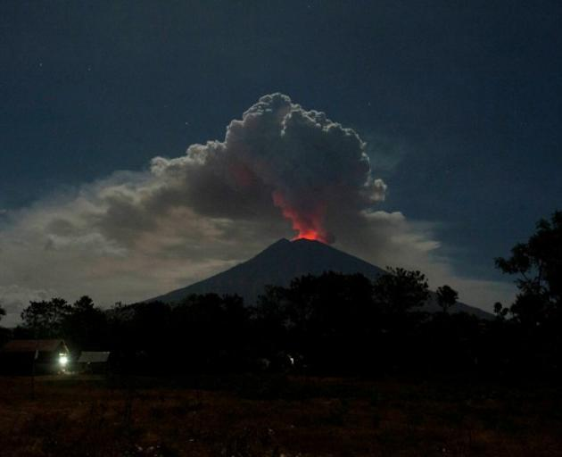 Mount Agung volcano erupts, as seen from Datah Village, Bali. Photo: Antara Foto/Nyoman Budhiana via Reuters