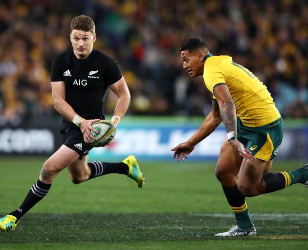 All Black first five-eighth Beauden Barrett runs past Wallaby fullback  Israel Folau during the...