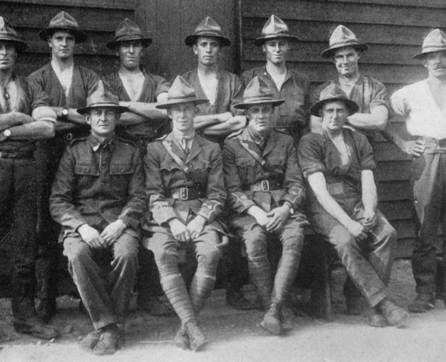 The 35th Reinforcements tug-o'-war team, winners of the championship at Suez Camp. Back row: L.-corp Townsend, Rflmn. Corner and McCallum, Corps. Campbell and Ford, L.-corp Slater, Corp Amos. Front row: Rflmn H. Healey (capt), Lieuts. Makeham and Fraser,