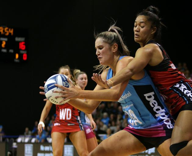 Steel goal attack Te Paea Selby-Rickit claims the ball ahead of Tactix defender Temalisi...