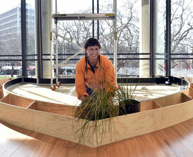 Aroha Novak works on creating her pool oasis at Dunedin Public Art Gallery. Photos: Peter McIntosh