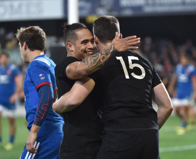 Ben Smith is congratulated by Aaron Smith in the test against France at Forsyth Barr Stadium in June this year. Photo: Peter McIntosh