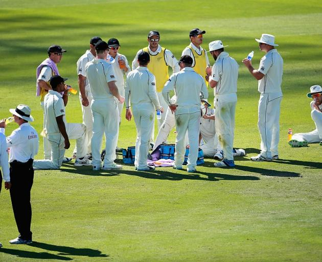 The Black Caps take a drinks break during their 2014 experience under the Abu Dhabi sun. Photo:...