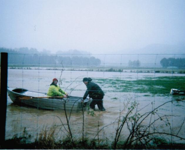 Scott Willis and Tony Puller in a boat in Waitati during the 2006 floods.