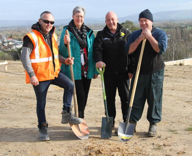 Turning a sod on Poole St for the Kaitangata house-and-land package project are (from left)...