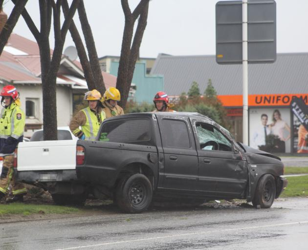Firefighters at the scene of the crash at the roundabout of Tweed and Clyde Sts in Invercargill. Photo: Sharon Reece