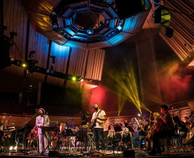 NZSO associate conductor Hamish McKeich (far left) and The Phoenix Foundation's Sam Scott (centre...