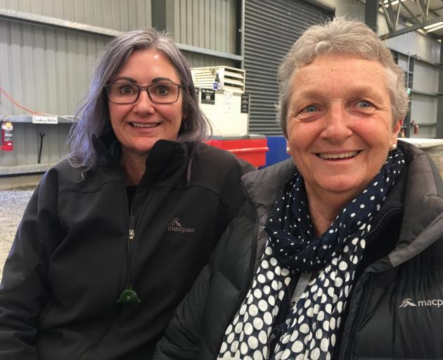 Jo Prouting, of Oamaru, and Jo Binnie, of Leeston, watch the action at the Southern Indoor...