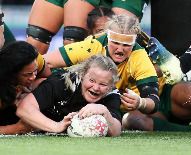 Phillipa Love of the Black Ferns scores a try (C) during the International Test match between the...
