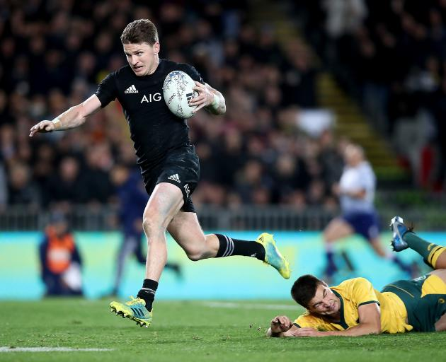 Beauden Barrett of the All Blacks breaks the Wallaby defence to score his third try during The...