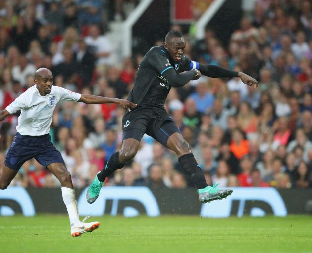 Usain Bolt (right) playing in a charity football match against fellow Olympian Mo Farah in...