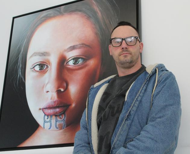 Invercargill artist Greg McDonald with his painting Descendant X, the subject of which will come...
