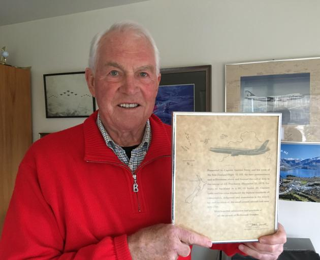 Arthur Dovey with the plaque he was presented with by McDonnell Douglas Corporation acknowledging...