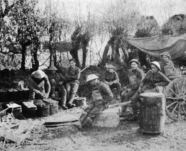 """Kapai te kai'': Maori pioneers awaiting their evening meal near the front on the Somme. - Otago..."