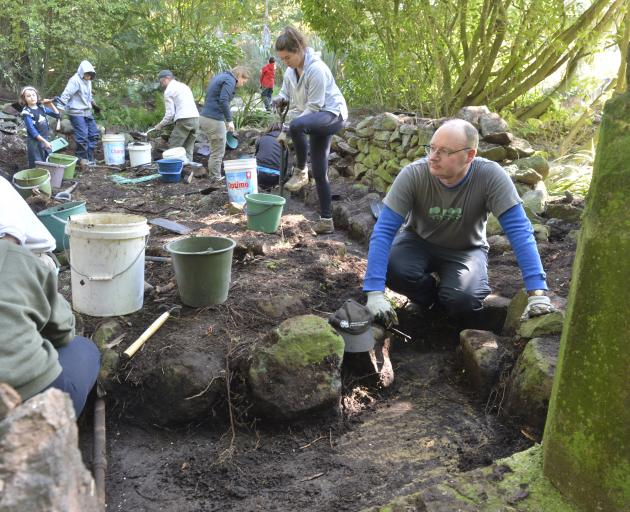 Heritage New Zealand Otago-Southland senior archaeologist Dr Matt Schmidt (right) and a team from...