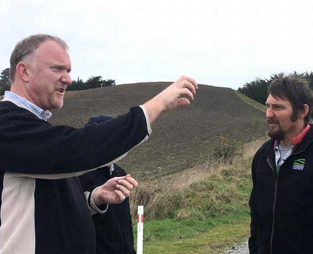 Otago Regional Council environmental services manager Martin King (left) discusses water quality...