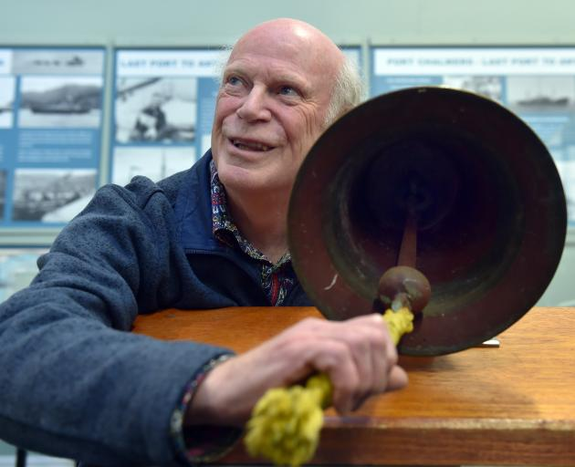 Port Chalmers Historical Society Inc president Brian McCormack with the MV Port Chalmers engine room bell which was given to the Port Chalmers Maritime Museum yesterday. Photos: Peter McIntosh