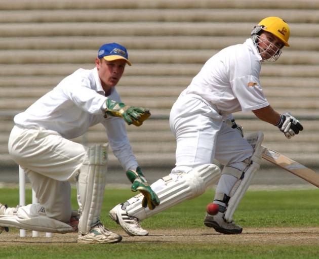 Otago wicketkeeper Martyn Croy watches the ball off the bat of Wellington batsman Matthew Bell in...