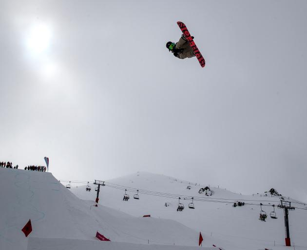 Kokomo Murase, of Japan, soars in the women's snowboard big air final during day six of  the Winter Games at Cardrona yesterday. Photo: Iain McGregor/Winter Games NZ