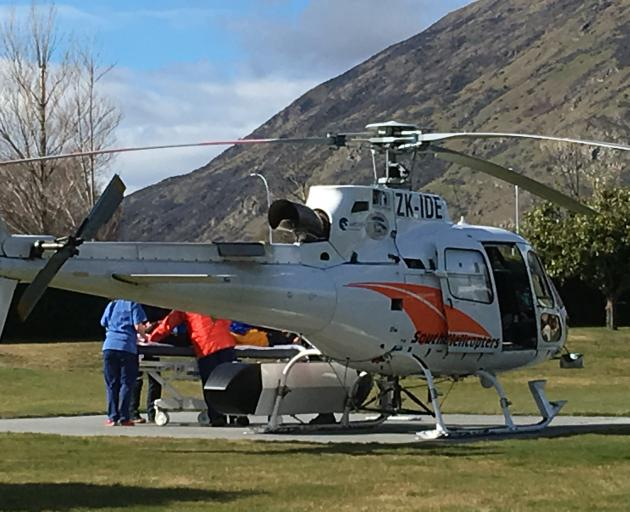 An injured snowboarder is taken off a Lakes District Air Rescue Trust helicopter at Lakes...