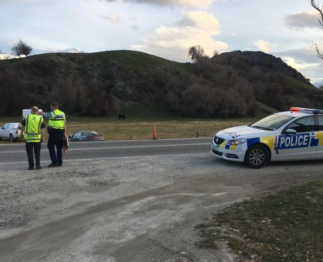 Police attend the scene of an traffic incident near Arrowtown this afternoon. Photo: Joshua Walton