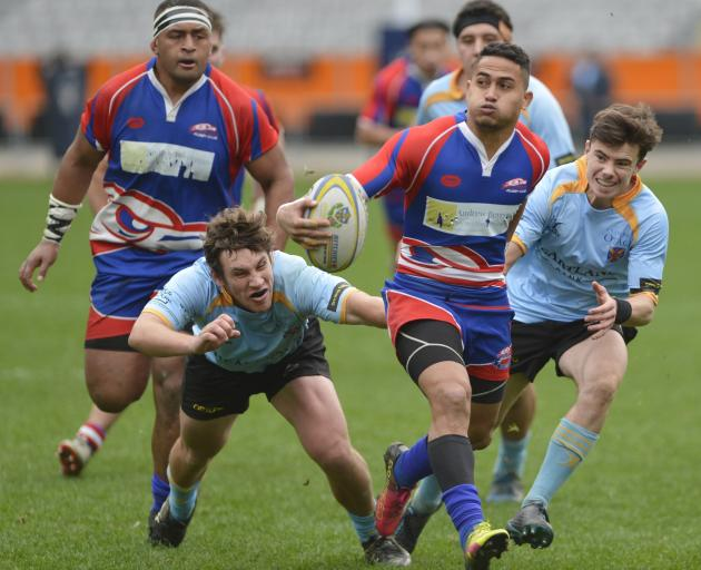 Harbour replacement Melani Matavao has Giorgio Bower in support as he evades University defenders...