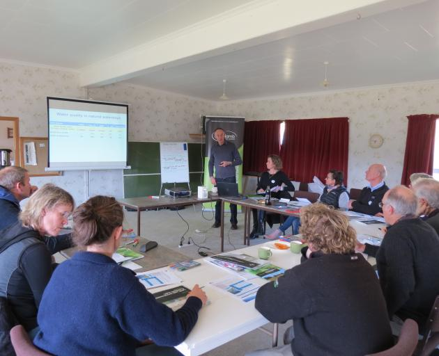Otago Regional Council's Bruce Monaghan, of Alexandra, takes farmers attending the Beef + Lamb New Zealand Land Environment Plan workshop, held in Millers Flat two weeks ago, through the council's environmental requirements. Beside him is Judy Miller, a s