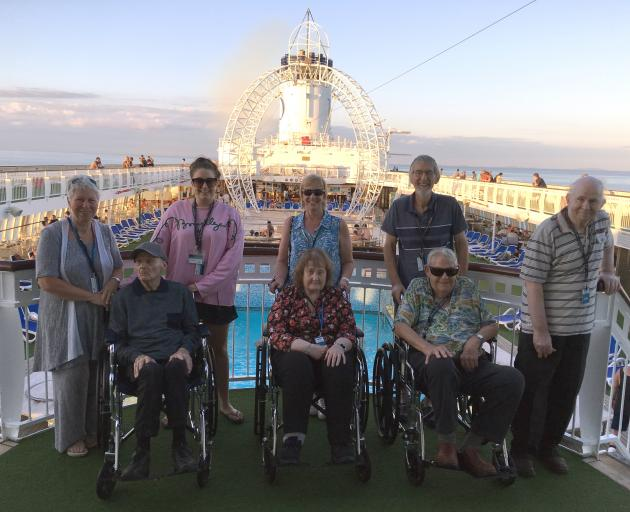 Glendale Retirement Home staff (back from left) diversional therapist Gayleen Dunn, caregiver Casey Brown, caregiver Nadine Brown, companion Ian Dunn and residents (front from left) Bob Wilson, Susan Blok, Gavin Nicol and Patrick Byrnes on their Fijian cr
