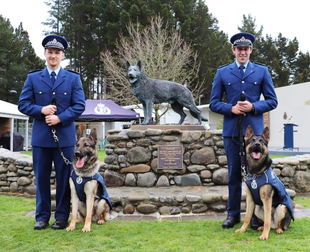 Constables Regan Wilson (left) and Marcus Saunders, both of Dunedin, with their respective dogs...