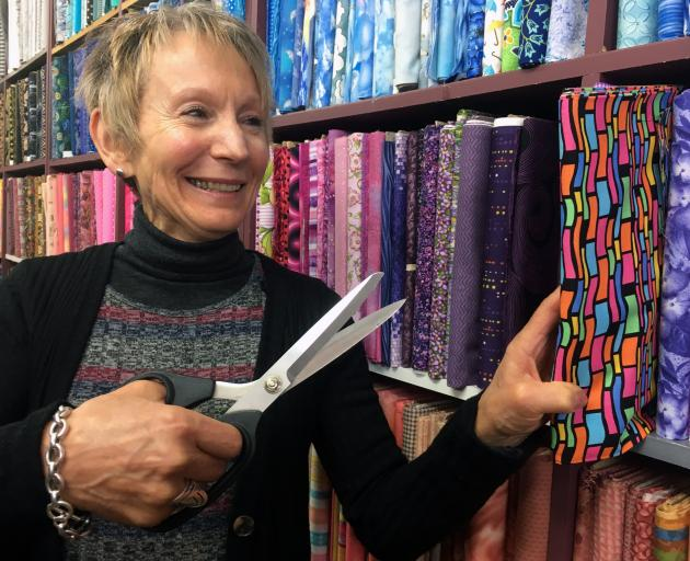 Threads Needlecrafts owner Sue McKinney is closing her patchwork and embroidery shop in Dunedin. Photo: Shawn McAvinue