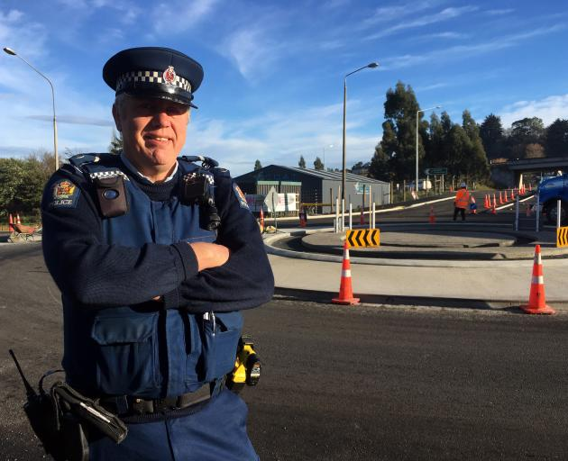 Senior Constable Fred Jansen is urging motorists to indicate correctly when navigating the three new roundabouts in Green Island. Photo: Shawn McAvinue
