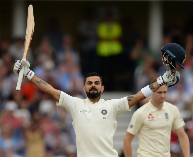 Virat Kohli celebrates his century as India took a big lead in the third test against England....