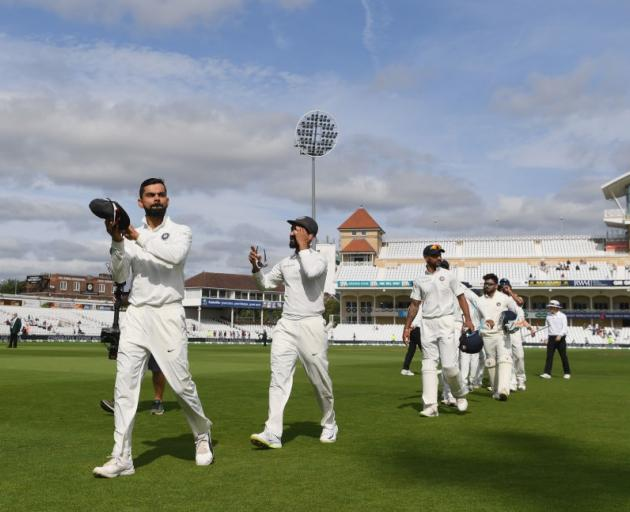Virat Kohli leads India off the field after its third test win over England. Photo: Getty Images