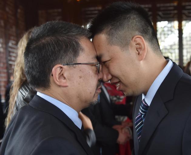 Dunedin Chinese Gardens Trust chairman Malcolm Wong (left) and a Shanghai Municipal Education...
