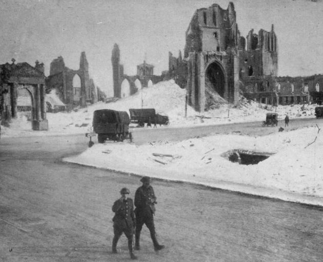 A kindly mantle of snow softens the lines of the ruined cathedral of Ypres. - Otago Witness, 28.8.1918.