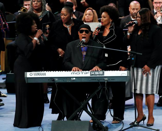 Stevie Wonder performs at the funeral service for the late singer Aretha Franklin at the Greater...