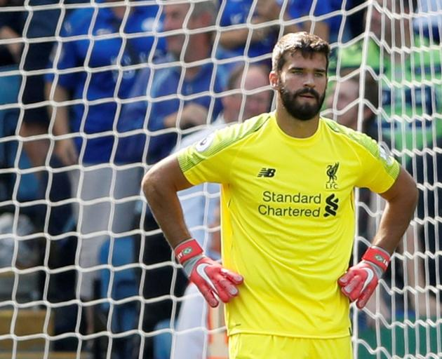 Liverpool's Alisson looks dejected after Leicester City's first goal. Photo: Reuters