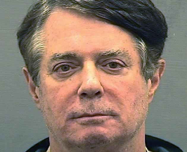 Former Trump campaign manager Paul Manafort is shown in a jail booking photo taken in Alexandria,...