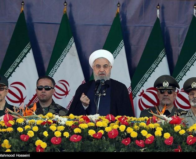 Iranian President Hassan Rouhani delivers a speech during the annual military parade in Tehran....