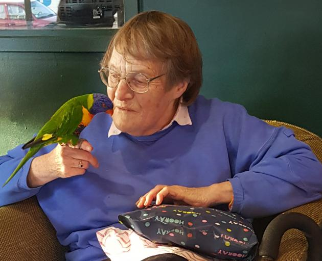 Jan Shallard, here with her friend's rainbow lorikeet Gary, was blown away by the kindness of strangers. Photo: Supplied