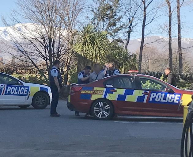 Police taking the man into custody. Photo: Daisy Hudson