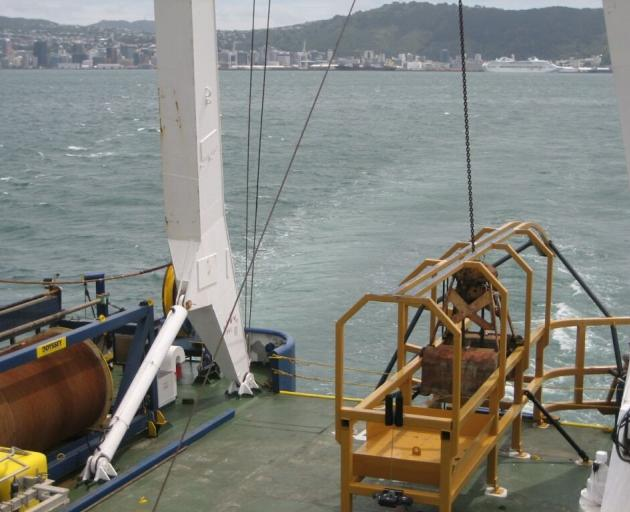 The grab bucket on the stern of a ship chartered by Chatham Rock Phosphate leaving Wellington in...