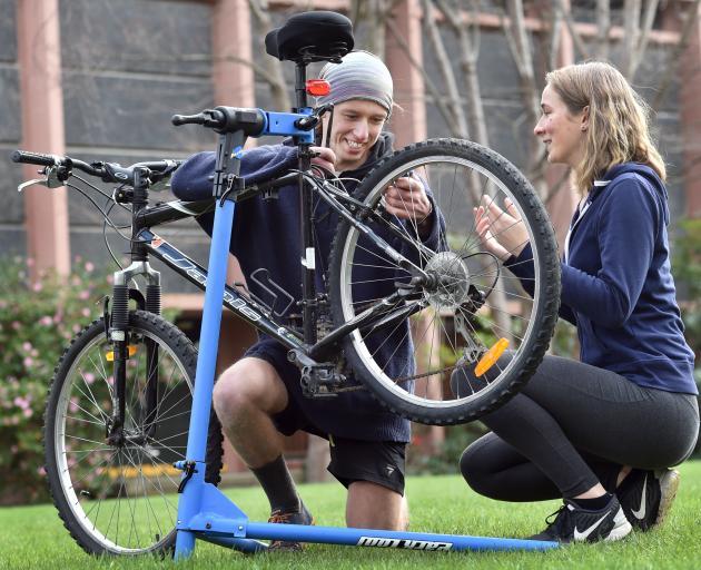 Volunteer bicycle repairer Alex Gorrie helps University of Otago student Yelah Mcdougall during an Enviro-Week event yesterday. Photo: Peter McIntosh
