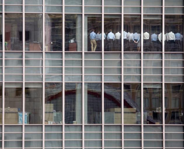 Bankers attend an emergency meeting at the London office of Lehman Brothers on September 11, 2008...