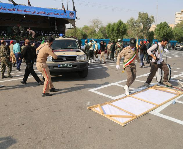 Iranian security forces take security measures after an armed attack targeting a military march...
