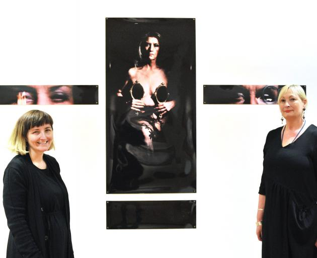 Hocken curator art, Andrea Bell (left) and head curator pictorial collections Robyn Notman flank a work by former Frances Hodgkins' Fellow Christine Webster. The work has been included in the ''Sisters Communing'' exhibition to celebrate 125 since women w