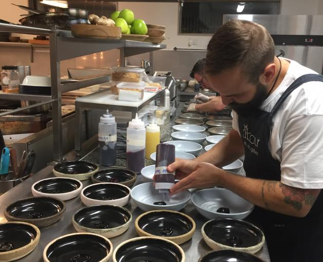 Lucas Parkinson works at Arbour Restaurant, in Blenheim, during his tour.