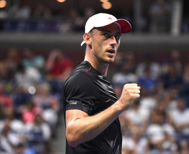 John Millman of Australia celebrates after defeating Roger Federer in the US Open. Photo: Reuters