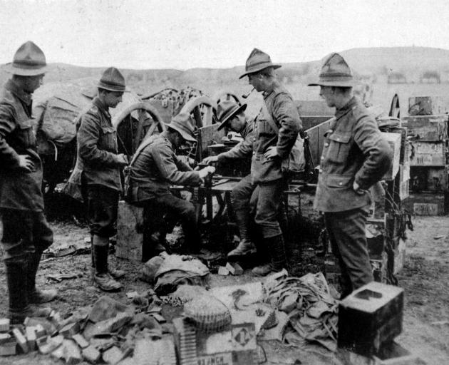 New Zealand machine gunners fitting belts with cartridges. - Otago Witness, 4.9.1918.